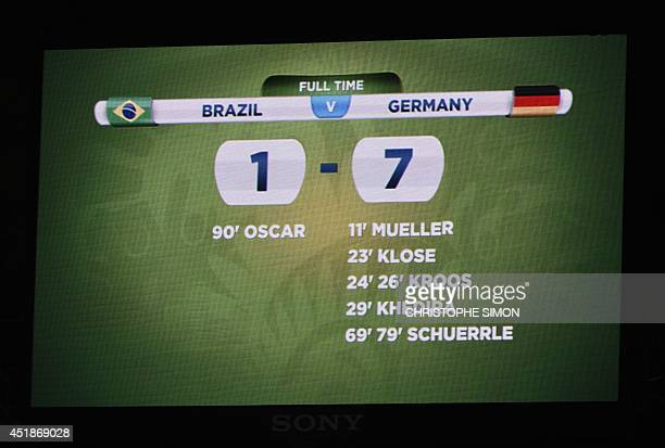 Scoreboard at the end of the semi-final football match between Brazil and Germany at The Mineirao Stadium in Belo Horizonte on July 8 during the 2014...