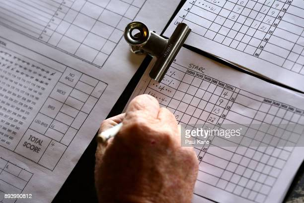 A scoreboard attendant records figures on a score sheet during day four of the Third Test match during the 2017/18 Ashes Series between Australia and...