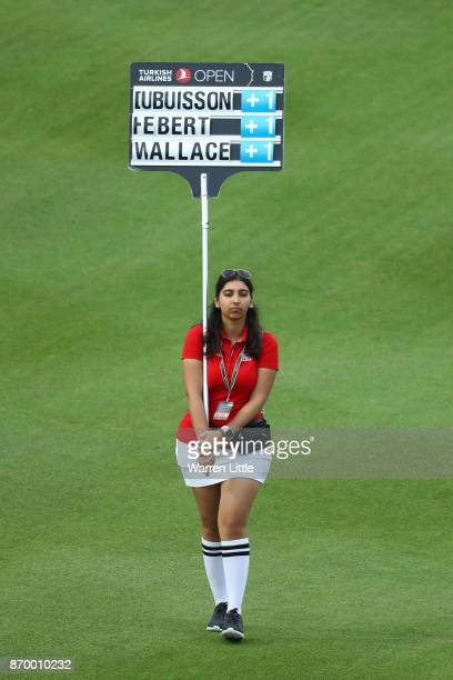 Scoreboard carrier walks down the 11th hole during the third round of the Turkish Airlines Open at the Regnum Carya Golf Spa Resort on November 4...
