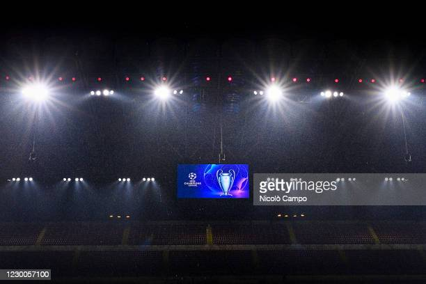 Scoreboard displays the logo and the trophy of UEFA Champions League during a heavy rainfall prior to the UEFA Champions League Group B football...