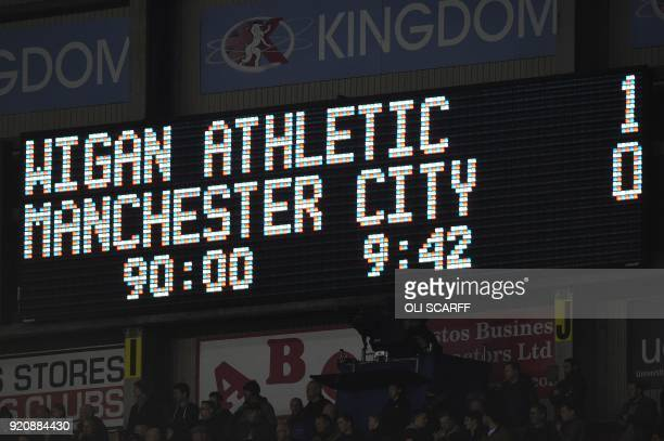 Scoreboard flashes during the English FA Cup fifth round football match between Wigan Athletic and Manchester City at the DW Stadium in Wigan...