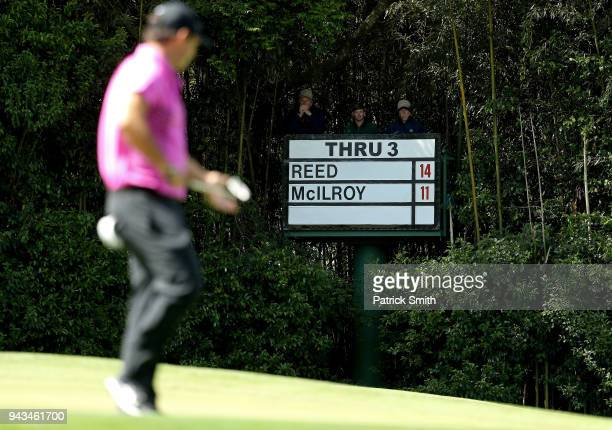 A scoreboard is seen as Patrick Reed of the United States plays the fourth green during the final round of the 2018 Masters Tournament at Augusta...