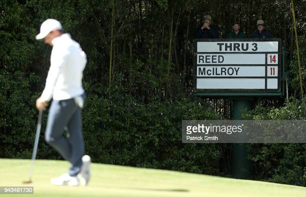A scoreboard is seen as Rory McIlroy of Northern Ireland plays the fourth green during the final round of the 2018 Masters Tournament at Augusta...
