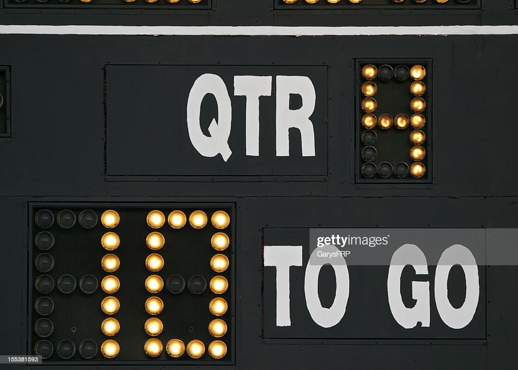 Scoreboard on American Football field yards to go and QTR : Stock Photo