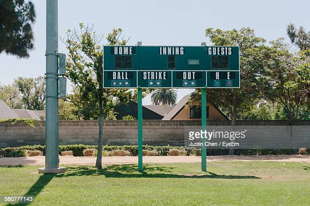 Scoreboard On Baseball Field Against Sky