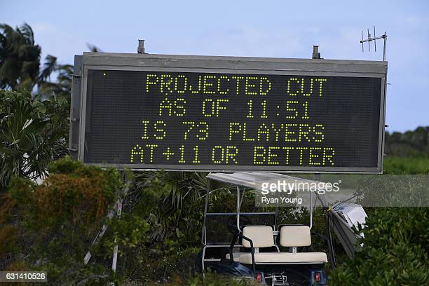 A scoreboard shows a projected cutline during the continuation of the second round of The Bahamas Great Exuma Classic at Sandals Emerald Bay Course...