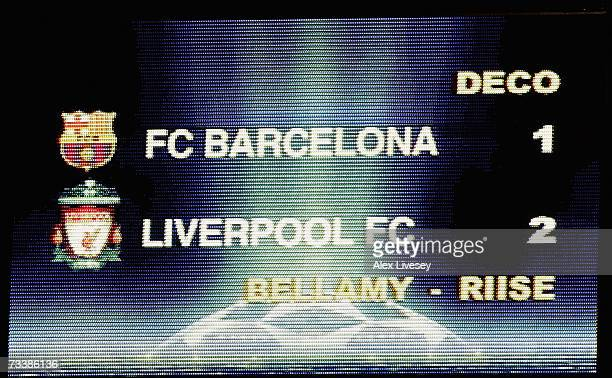 A scoreboard shows the result of the UEFA Champions League round of 16 first leg match between Barcelona and Liverpool at the Nou Camp Stadium on...