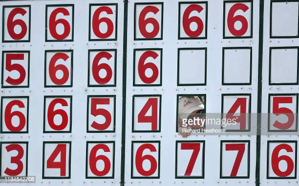 A scoreboard worker watches the golf through a number hole during the second round of the Arnold Palmer Invitational Presented by Mastercard at the...