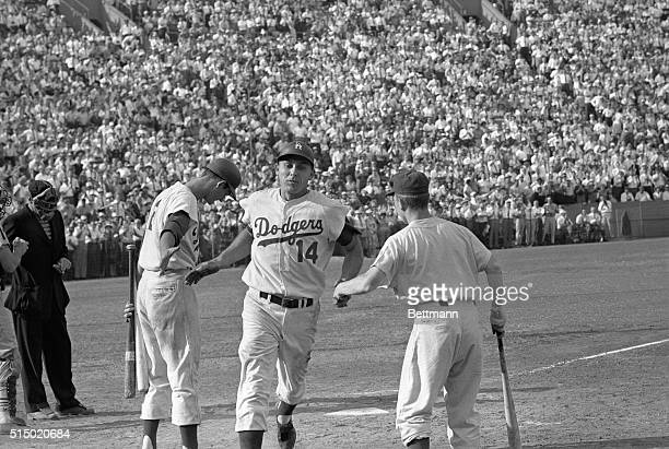 Scored Winning Run Los Angeles Calif Dodger Gil Hodges is greeted by teammate Don Demeter and Dodger batboy as he crosses the plate after hitting the...