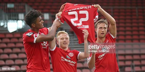 Scorer Aaron Seydel Patrick Pfluecke and Ville Matti Steinmann of Mainz 05 II celebrate with a jersey during the Third League match between 1FSV...
