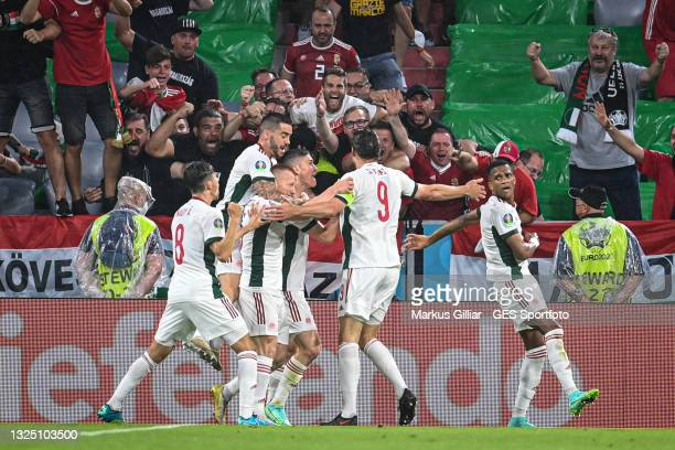 Scorer Adam Szalai of Hungary celebrates his team's first goal with his team members and fans during the UEFA Euro 2020 Championship Group F match...