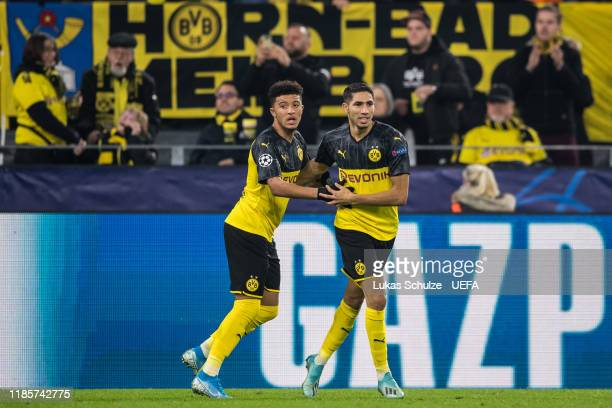 Scorer Aschraf Hakimi celebrates his team's first goal with Jadon Sancho during the UEFA Champions League group F match between Borussia Dortmund and...