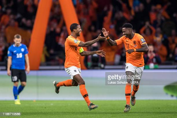 Scorer Georginio Wijnaldum of Netherlands celebrates his team's first goal with Quincy Promes of Netherlands during the UEFA Euro 2020 Qualifier...