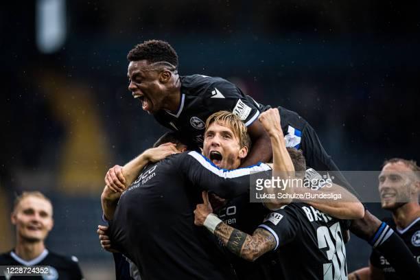 Scorer Joan Simun Edmundsson of Bielefeld celebrates his teams first goal with Anderson Lucoqui and his team mates of Bielefeld during the Bundesliga...