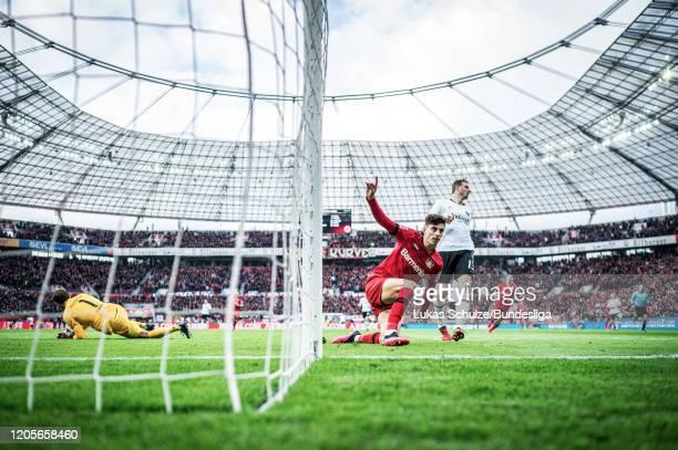 Scorer Kai Havertz of Leverkusen celebrates his teams first goal during the Bundesliga match between Bayer 04 Leverkusen and Eintracht Frankfurt at...
