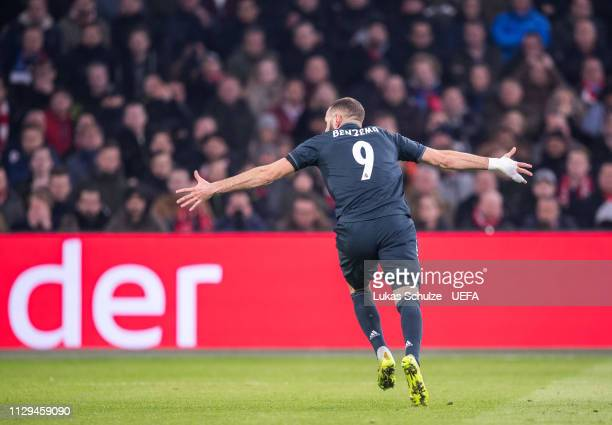Scorer Karim Benzema of Madrid celebrates his team's first goal during the UEFA Champions League Round of 16 First Leg match between Ajax and Real...
