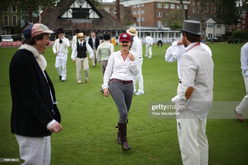 Scorer Laura Jeffrey (C) stands with members of the Wisden XI and the Authors XI before a Victorian cricket match at Vincent Square on May 29, 2013 in London, England. The match celebrates the 150th anniversary the Wisden Cricketers' Almanack. The almanack is a cricket reference book published annually in the United Kingdom.