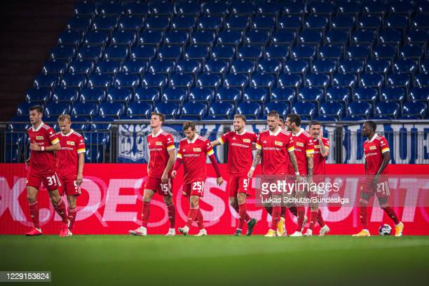 Scorer Marvin Friedrich of Berlin celebrates his teams first goal with team mates during the Bundesliga match between FC Schalke 04 and 1. FC Union...