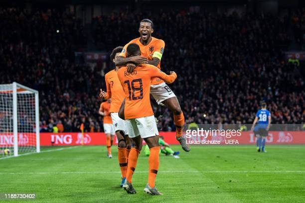 Scorer Myron Boadu celebrates his team's fifth goal with Georginio Wijnaldum and Calvin Stengs of Netherlands during the UEFA Euro 2020 Qualifier...