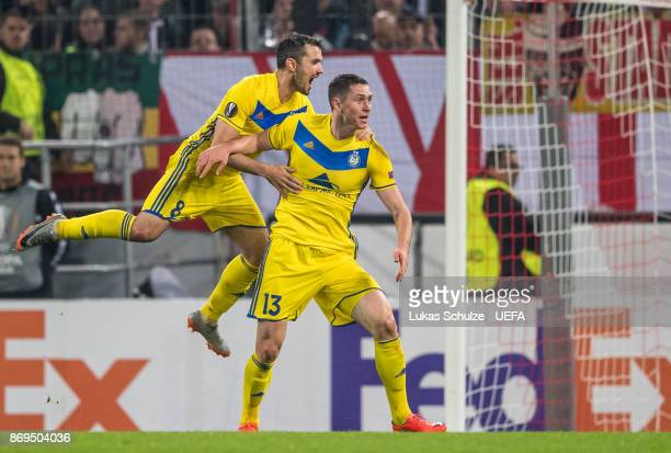 Scorer Nikolai Signevich of Borisov celebrates his teams second goal with Aleksandr Volodko of Borisov during the UEFA Europa League group H match...