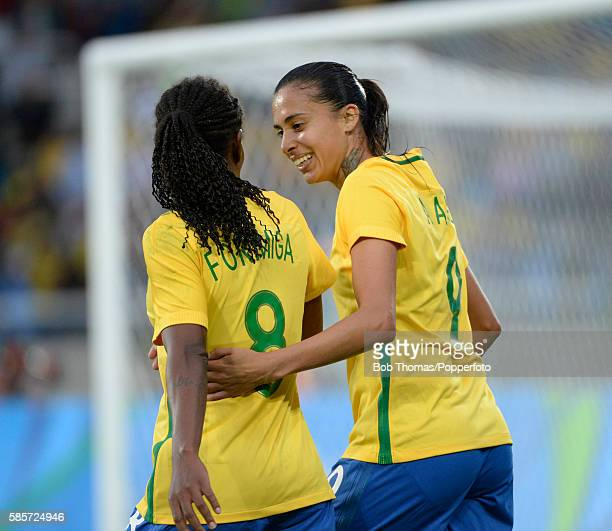 Scorer of Brazil's second goal Andressa Alves celebrates with Formiga during the Women's Group E first round match between Brazil and China PR during...