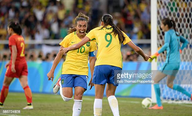 Scorer of Brazil's second goal Andressa Alves celebrates with Marta during the Women's Group E first round match between Brazil and China PR during...
