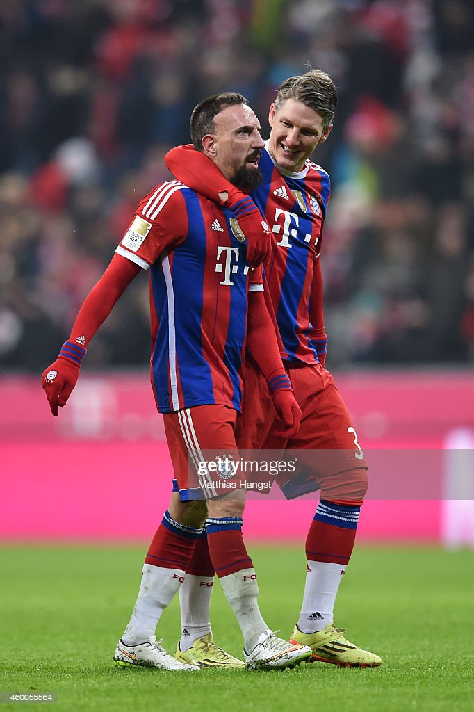 Scorer of the matchwinning goal Franck Ribery of Bayern Muenchen is congratulted by teammate Bastian Schweinsteiger of Bayern Muenchen following their team's 1-0 victory during the Bundesliga match between FC Bayern Muenchen and Bayer 04 Leverkusen at the Allianz Arena on December 6, 2014 in Munich, Germany.