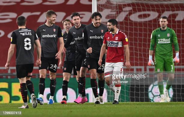 Scorer of the second Rotherham goal, Michael Smith and team mates, share a joke with Middlesbrough player Sam Morsy during the Sky Bet Championship...