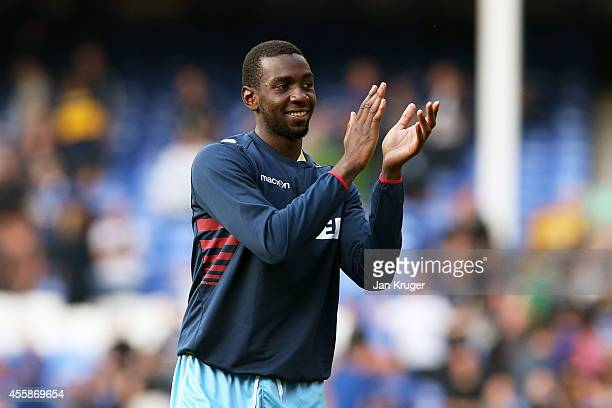 Scorer of the winning gal Yannick Bolasie of Crystal Palace applauds the travelling fans following their team's 32 victory during the Barclays...