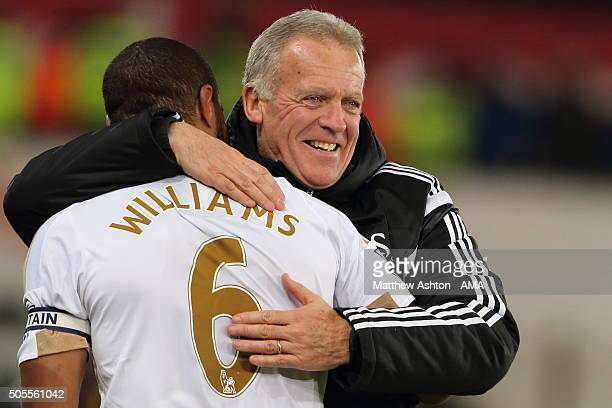 Scorer of the winning goal Ashley Williams of Swansea City is hugged by Alan Curtis the head coach / manager of Swansea City after the Barclays...