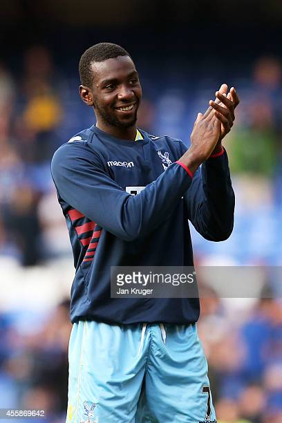 Scorer of the winning goal Yannick Bolasie of Crystal Palace applauds the travelling fans following their team's 32 victory during the Barclays...