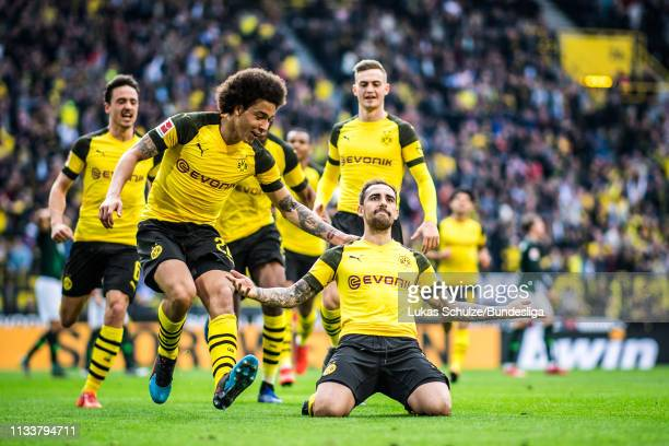 Scorer Paco Alcacer of Dortmund celebrates his team's first goal with Axel Witsel , Thomas Delaney and Jacob Bruun Larsen of Dortmund during the...