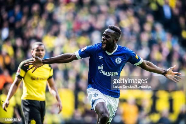 Scorer Salif Sane of Schalke celebrates his teams second goal during the Bundesliga match between Borussia Dortmund and FC Schalke 04 at Signal Iduna...