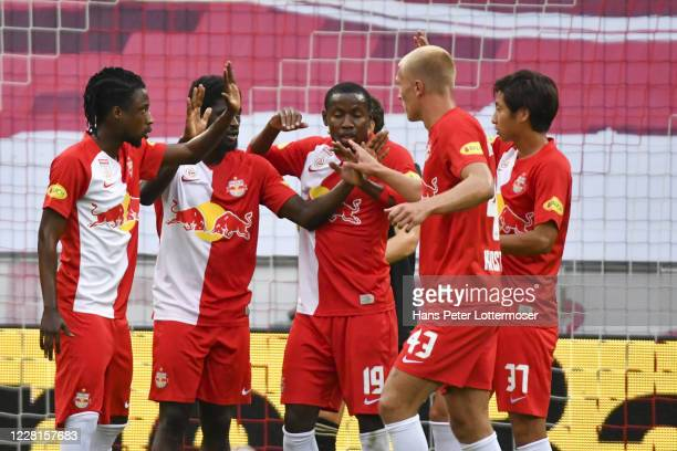 Scorer Sekou Koita of Salzburg celebrates with teammates during the Pre-Season Friendly match between FC Red Bull Salzburg and AJAX Amsterdam at Red...
