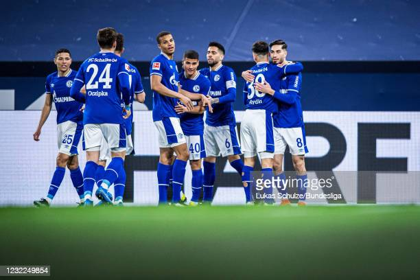 Scorer Suat Serdar celebrates his teams first goal with his team mates during the Bundesliga match between FC Schalke 04 and FC Augsburg at...