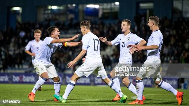 Scorer Timon Burmeister celebrates his teams first goal with Marvin Obuz Albin Thaqi and Sebastian Papalia of Germany during the friendly match...