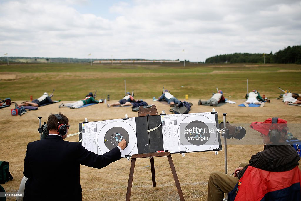 Scorers fill in their shooter's scorecard during the final of the HM Queen's Prize during the NRA Imperial Meeting at the National Shooting Centre on July 20, 2013 in Bisley, England.