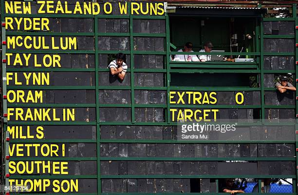 Scorers watch from the old scoreboard during the Twenty20 International match between the New Zealand Black Caps and the West Indies at Eden Park on...