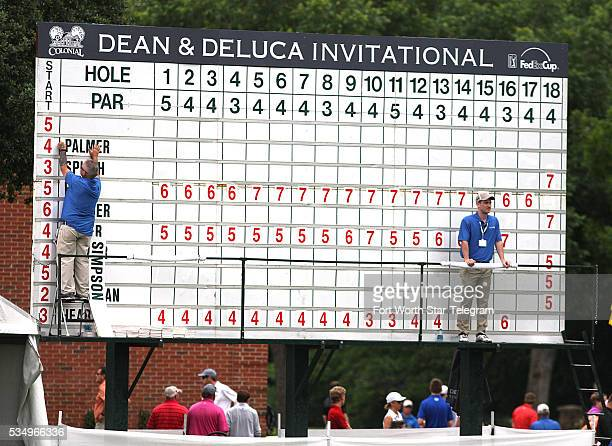 Scores are posted on a manual scoreboard during the third round of the Dean & DeLuca Invitational at Colonial Country Club in Fort Worth, Texas, on...