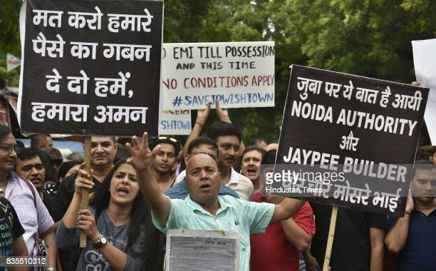 Scores of home buyers of Jaypee Infratech affected by delayed possessions stage a protest at Jantar Mantar on Saturday and threaten to commit suicide...