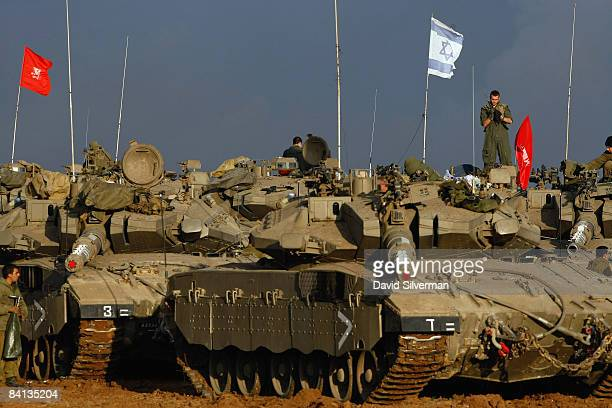 Scores of Israeli army tanks and armored personnel carriers are massed on December 29 2008 near Israel's border with the Gaza Strip Israeli Air Force...