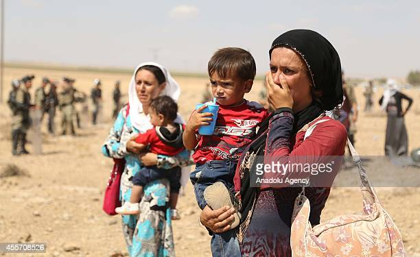 Scores of Syrians gathering on Turkish border for the last two days after fleeing clashes between the Islamic State of Iraq and Levant militants and...