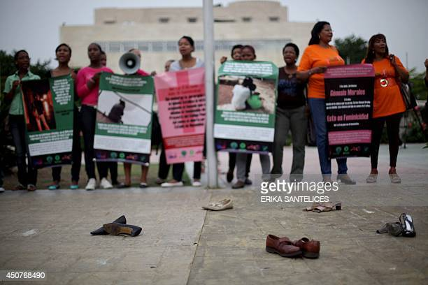 Scores of women demonstrate on June 17 2014 in front of the National Congress in Santo Domingo against a Penal Code Reform in the process of being...
