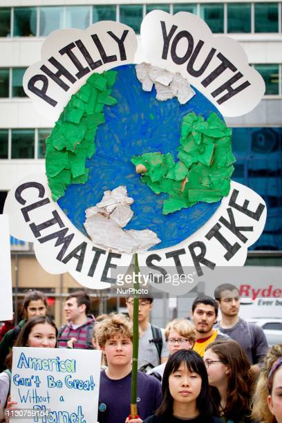 Scores of young people including many students staging a walkout from school attend the Philly Youth Climate Strike in Philadelphia's Love Park in...