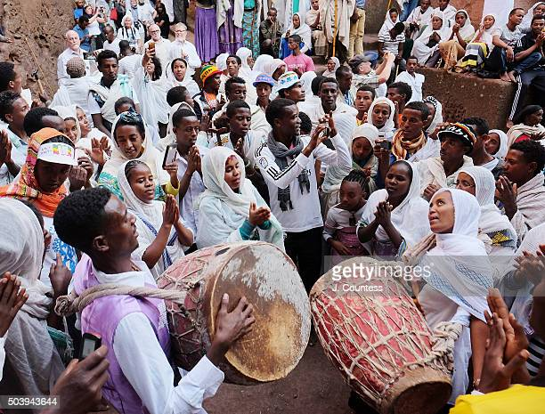 Scores of youth from various youth choirs in Ethiopia dance and sing at Beta Giyorgis Church on January 7 2016 in Lalibela Ethiopia Thousands of...