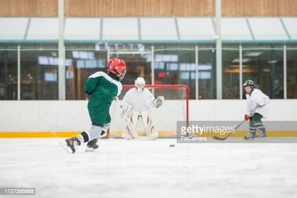 scoring a goal - fat goalkeeper stock pictures, royalty-free photos & images