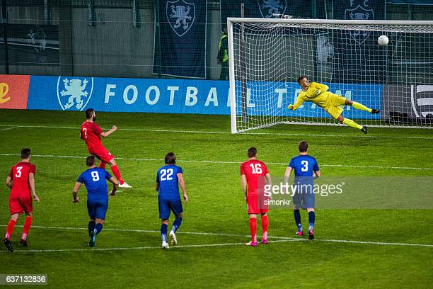 scoring a goal - goalie goalkeeper football soccer keeper stock pictures, royalty-free photos & images