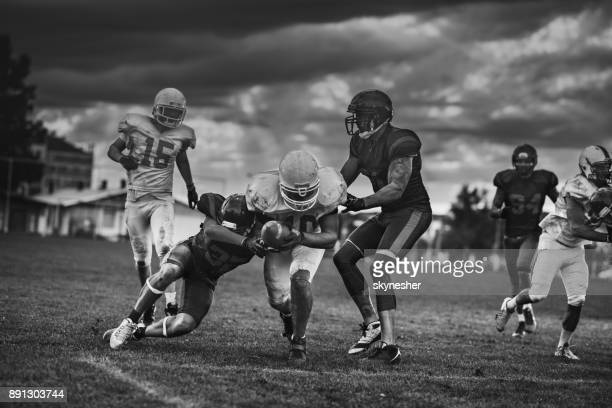 Scoring touchdown on American football match! Black and white photography.