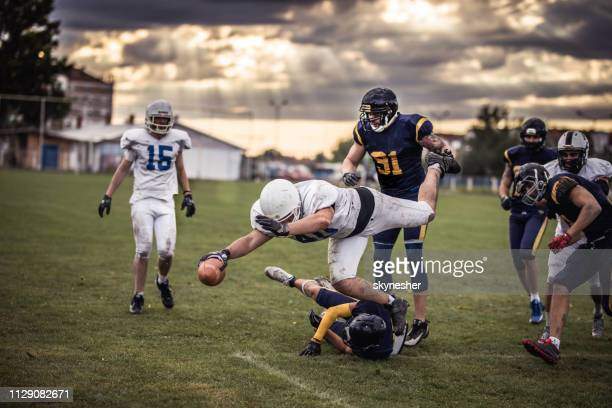 scoring touchdown! - quarterback stock photos and pictures