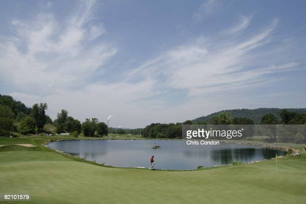 A scoring volunteer walks across the expansive 13th green during the third round of the Nationwide Tour Players Cup held at Pete Dye Golf Club on...